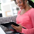 African woman studying at home — Stock Photo #24889333