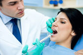 Dentist anesthetizing patient — Stock Photo