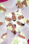 Six women standing with their heads in circle — Stock Photo