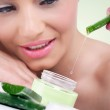 Young woman with natural aloe vera cream — Stock Photo #24890663