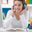 Teenager girl listening music — Stockfoto