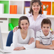 Smiling mother with her children — Stock Photo