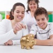Happy family with piggybank — Stock Photo