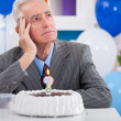 Man having  Alzheimer's disease on birthday - Stock Photo