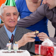 Senior man with children on birthday — Stock Photo
