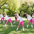Group of women stretching — Stock Photo
