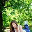 Attractive girl relaxing in park — Stock Photo