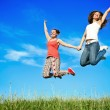 Happiness young women jumping — Stock Photo