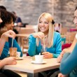 Royalty-Free Stock Photo: Teenagers enjoy in coffee