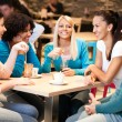 Young friends in cafe — Stock Photo #24893253