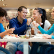 Group of teenagers enjoying in lunch - Stock Photo