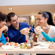 Happy teenagers having lunch — Stock Photo #24893767