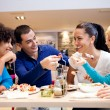 Stock Photo: Happy teenagers having lunch
