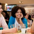 Teenagers girls in cafe — Stock Photo
