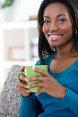 African woman enjoying in coffee — Stock Photo