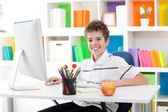 Smiling boy using a computer — Stock Photo