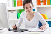 Woman using a graphic tablet and pen — Stock Photo