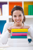 Cheerful schoolgirl with books — Stock Photo