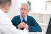 Senior patent with doctor — Stock Photo