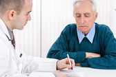 Doctor with senior patient — Stock Photo