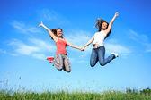 Jumping girls — ストック写真
