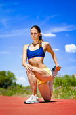 Sporty woman Stretching Quadriceps — Stock Photo