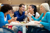 Group of teenagers enjoying in lunch — Stock Photo