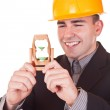 Young engineer with hourglass — Stock Photo #2626752