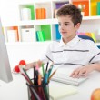 Smiling boy using computer — Stock Photo #28283545