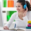Homework with headphones — Stockfoto