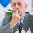 Senior man celebrates birthday — Stock Photo