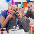Stock Photo: Family celebrating 70th birthday
