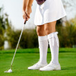 Golfer swing golf ball on the grass — Stock Photo