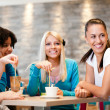 Friends enjoying coffee together — Stock Photo