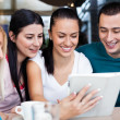 Teenagers using digital tablet — Stockfoto