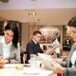 Stock Photo: Business people in cafe