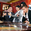 Two couple gambling in casino — Stock Photo
