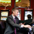 Happy man gambling  — Stockfoto