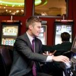 Happy man gambling — Stock Photo #28285707