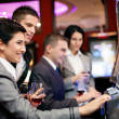 People gambling on slot machines — Stock Photo