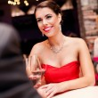 Woman in red dress in restaurant — Stock Photo