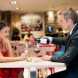 Gentlemen pouring wine his girlfriend — Stock Photo