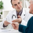 Doctor giving a prescription — Stockfoto