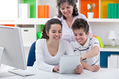 Family have fun with tablet pc — Stock Photo