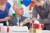 Senior man celebrating his birthday with family — Stock fotografie