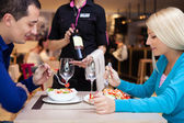 Nice dinner in a restaurant - waiter offers wine — Stock Photo