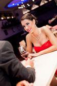 Beautiful woman with boyfriend in restaurant — Stock Photo