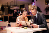 Couple with menu card — Stock Photo
