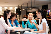 Group of young women on coffee break — Stock Photo