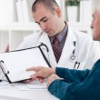 Senior man consulting with doctor — Stock Photo